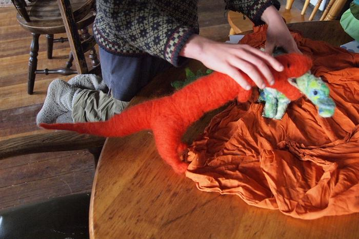 child playing with needle felted dragons natural wool non-toxic toys