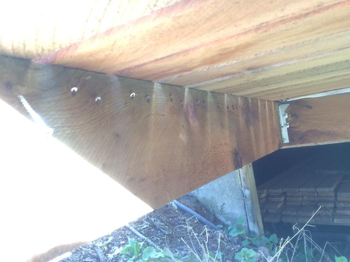 Underneath view of the screws going into the decking boards